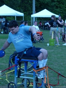 "a participant uses an assistive device to compete in the field event ""discus"""