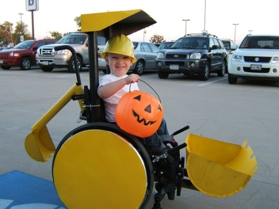 a child dressed as a bulldozer