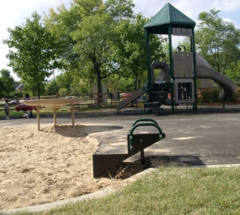 This sand play area offers an accessible sand table and a transfer system.