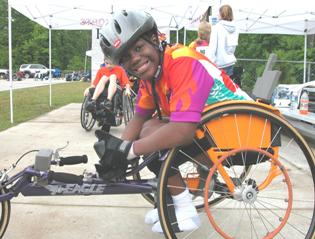 A youth in his racing wheelchair.