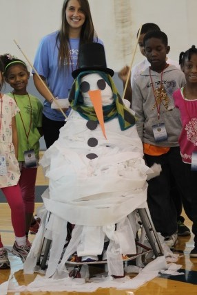 a group makes a toilet paper snow man