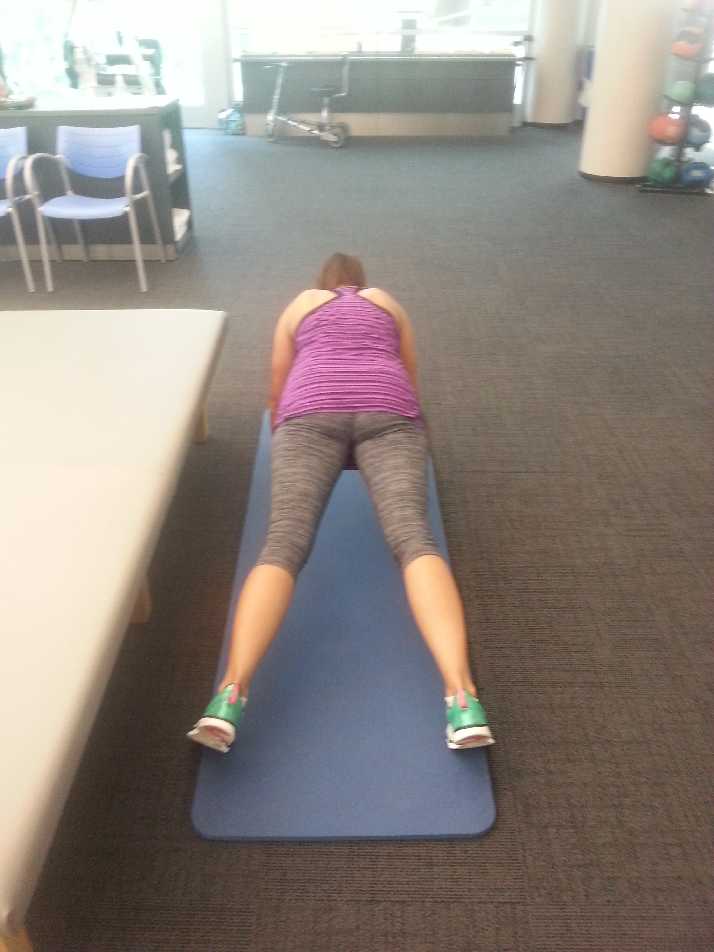 the out feet position for plank jacks