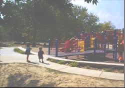 Accessible playgrounds for children with and without disabilities shows the side view of an access ramp into the playground system