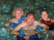 Henry Moss working with Carolyn and Lisa at Aqua Abilities