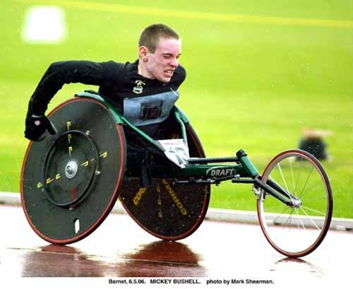 Image of a young man with an amputation using a lumbar sacral spinal agenesis using a T53 wheelchair racer.