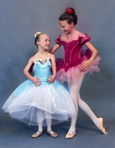 Two young girls in their ballet dresses